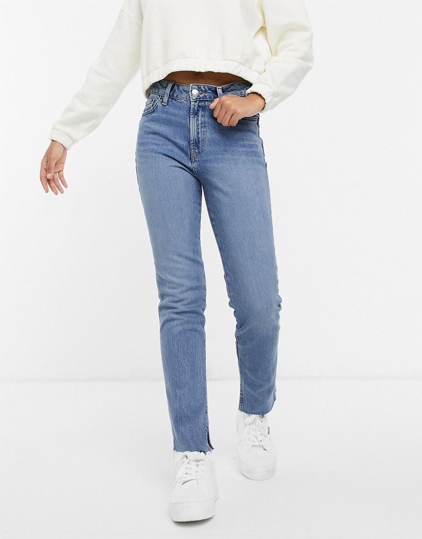 ASOS DESIGN mid rise vintage 'skinny' jeans in midwash with split hem-Blue