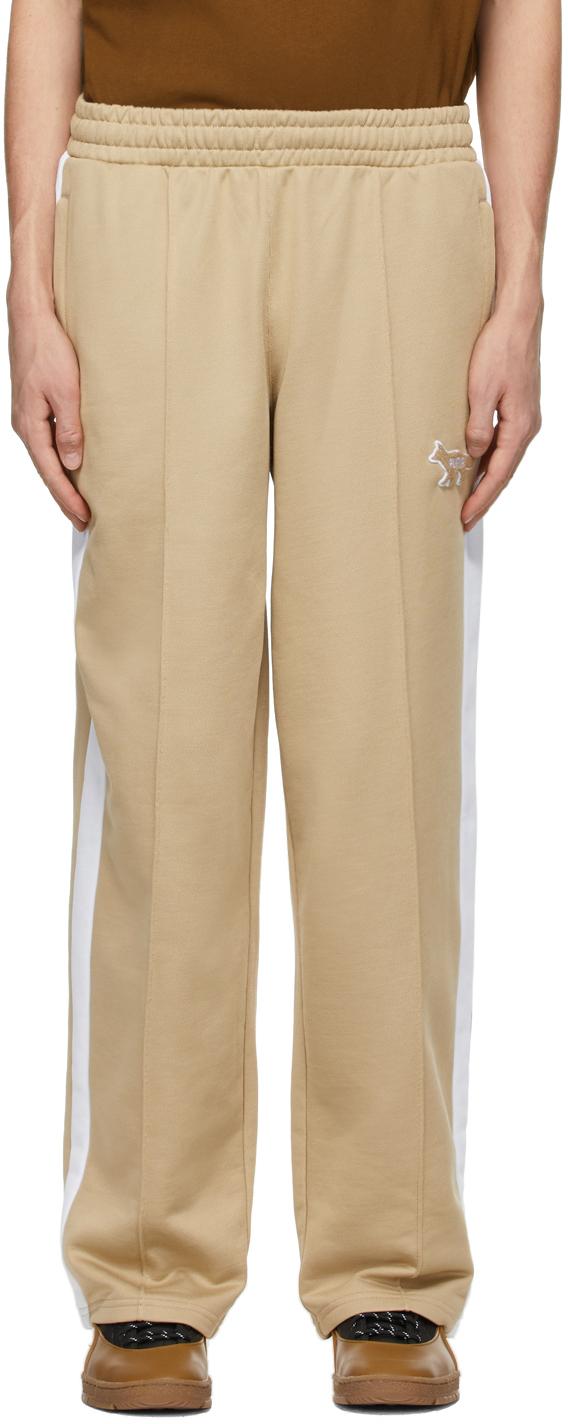 Maison Kitsuné SSENSE 独家发售酒红色 Puma 联名 T7 运动裤