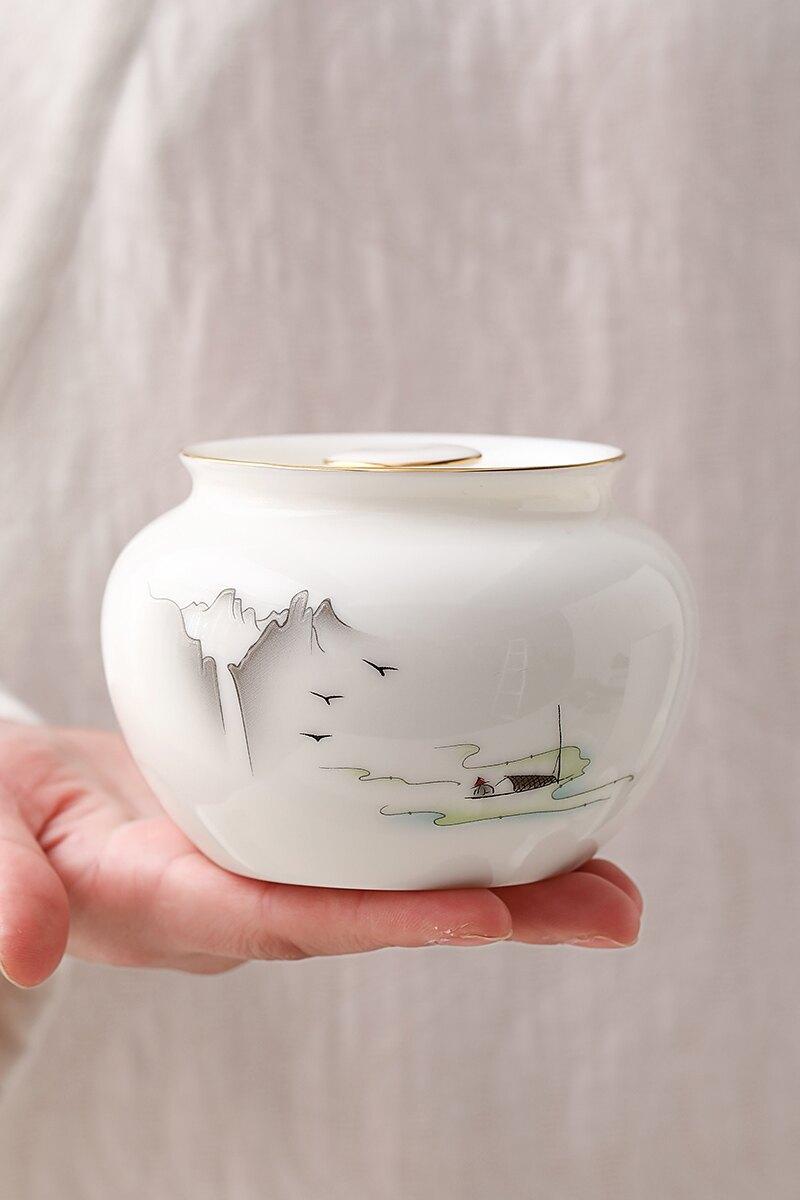 輕奢羊脂玉白瓷茶葉罐小號普洱茶密封罐陶瓷中式便攜創意錫罐家用