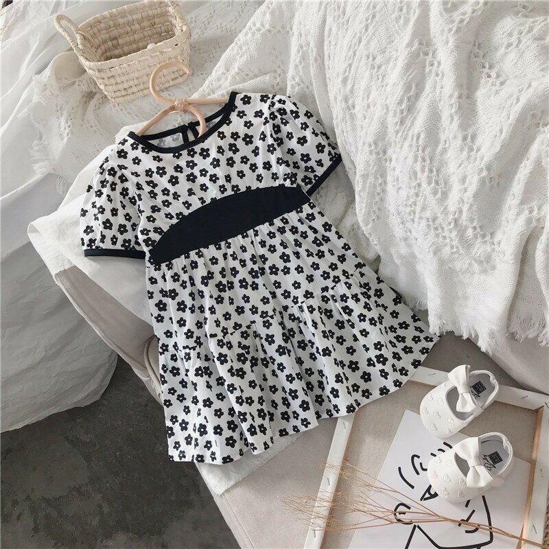 女童連衣裙2021夏季新款韓版白底黑花女寶寶碎花拼接裙外貿
