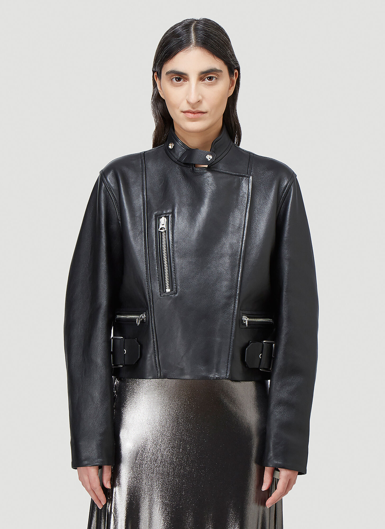female Black 100% lamb leather. Dry clean.