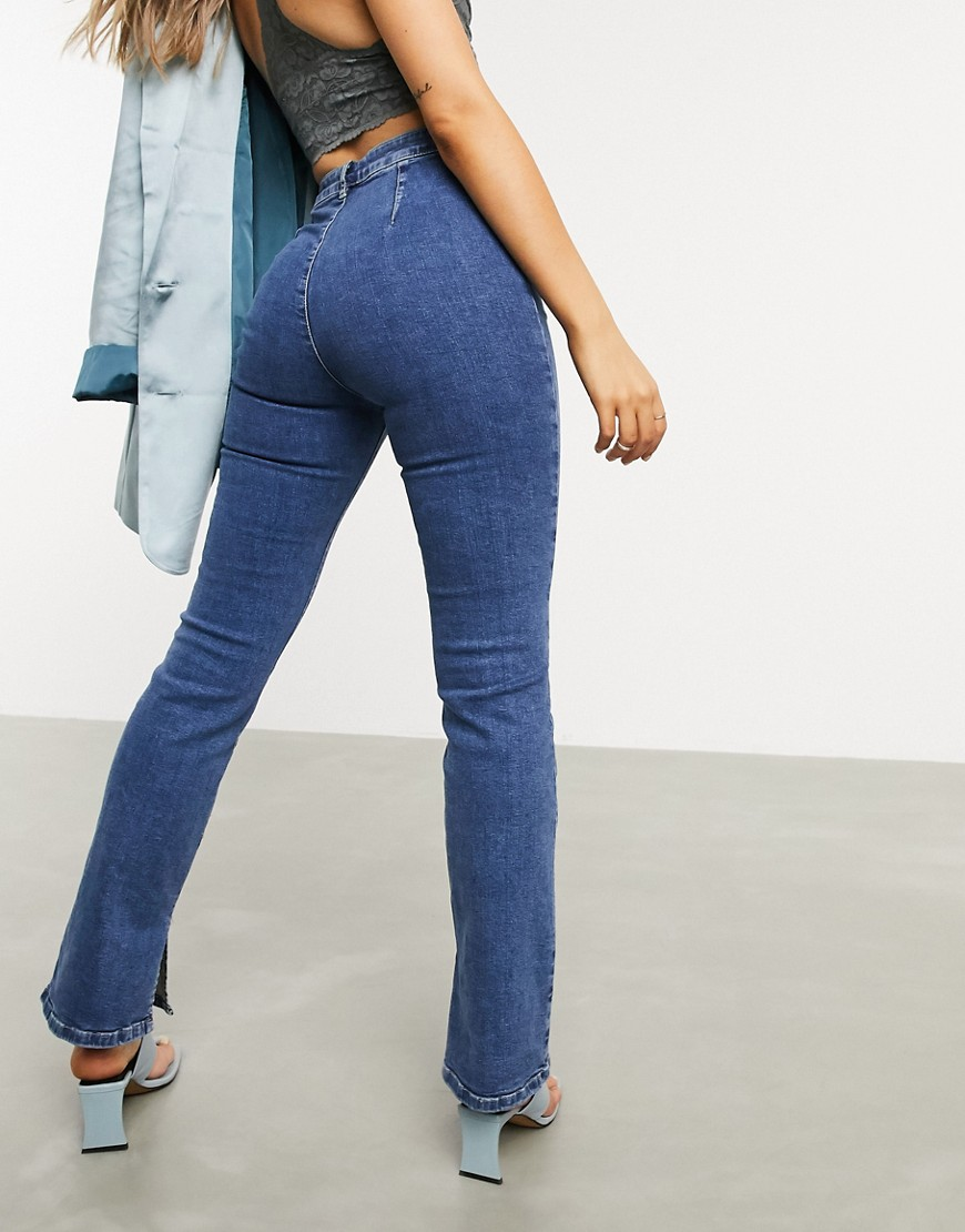 ASOS DESIGN high rise 'Y2K' stretch flare jeans in midwash-Blue