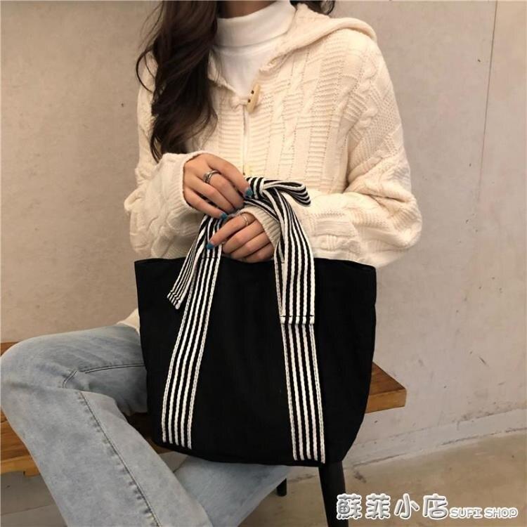 韓國東大門時尚簡約蝴蝶結帆布包女手挽暗黑系百搭小清新手提包潮
