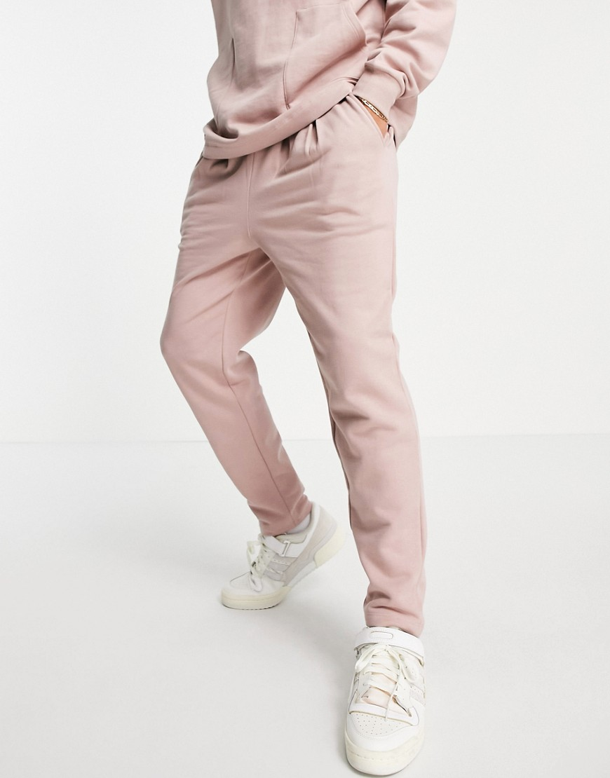 ASOS DESIGN co-ord pleated joggers in pink