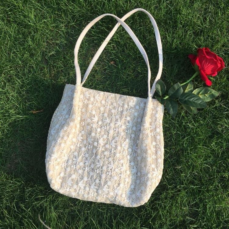 春夏仙女蕾絲百搭大容量水桶手提草編編織女包包單肩小清新購物袋