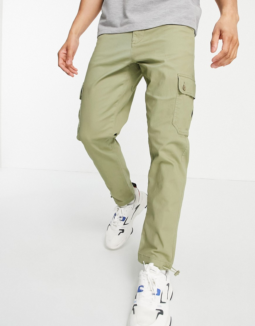 ASOS DESIGN tapered cargo trousers in light green with toggles