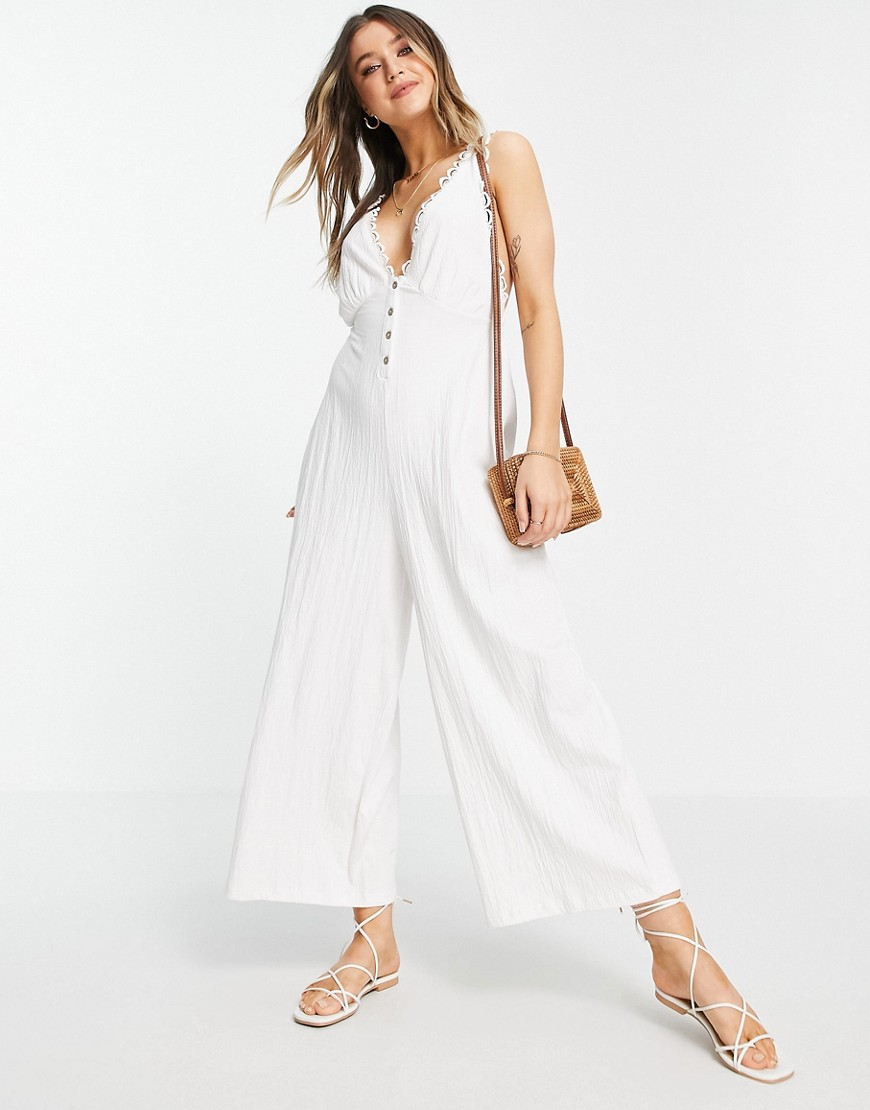 ASOS DESIGN button front lace trim swing jumpsuit in white