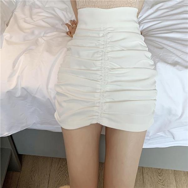 窄裙 半身裙女氣質2021夏季新款時尚白色高腰包臀裙設計感小眾褶皺短裙 歐歐