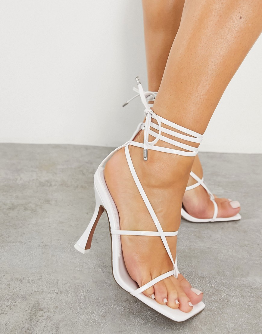ASOS DESIGN Nello tie leg toe thong heeled sandals in white