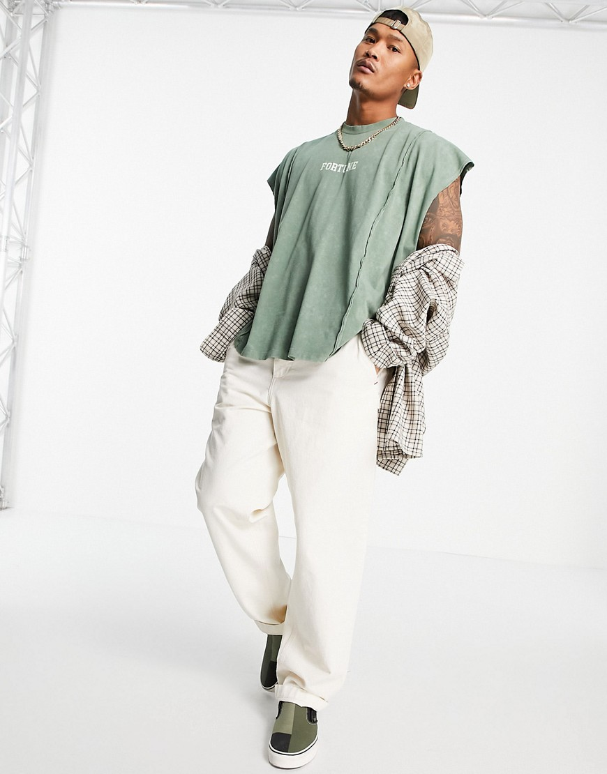 ASOS DESIGN oversized vest in green with dipped hem and text print