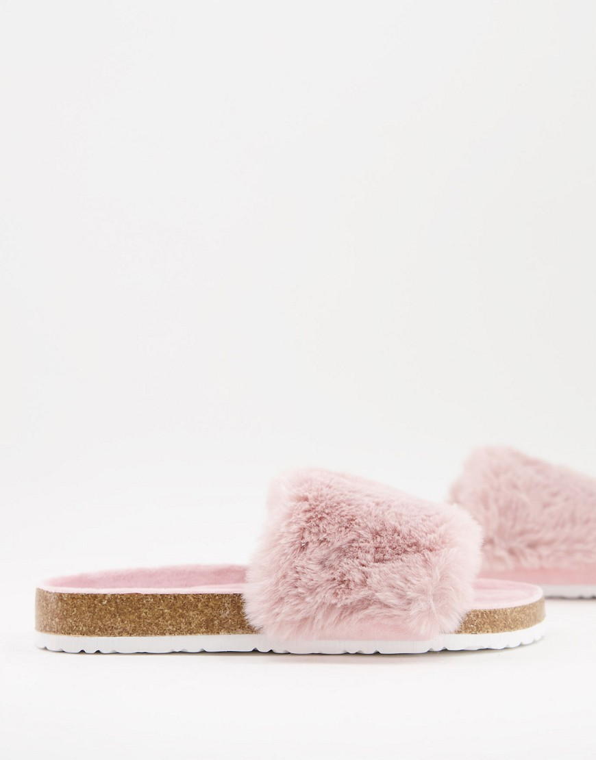 Accessorize fluffy sliders in pink
