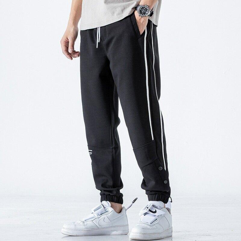 夏季運動休閒褲男大碼寬鬆束腳籃球排扣側條紋針織衛褲