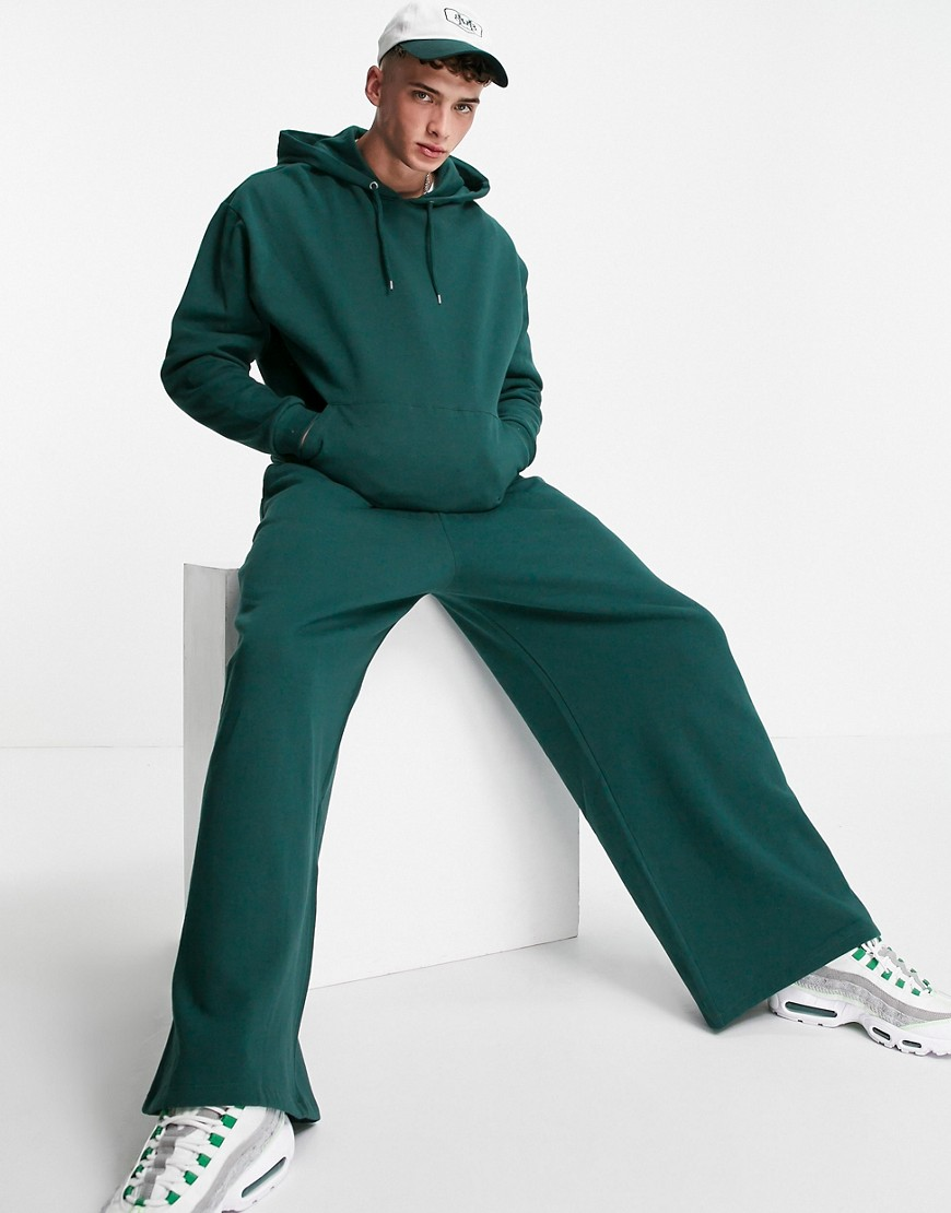 ASOS DESIGN oversized tracksuit with hoodie and wide leg joggers in forest green