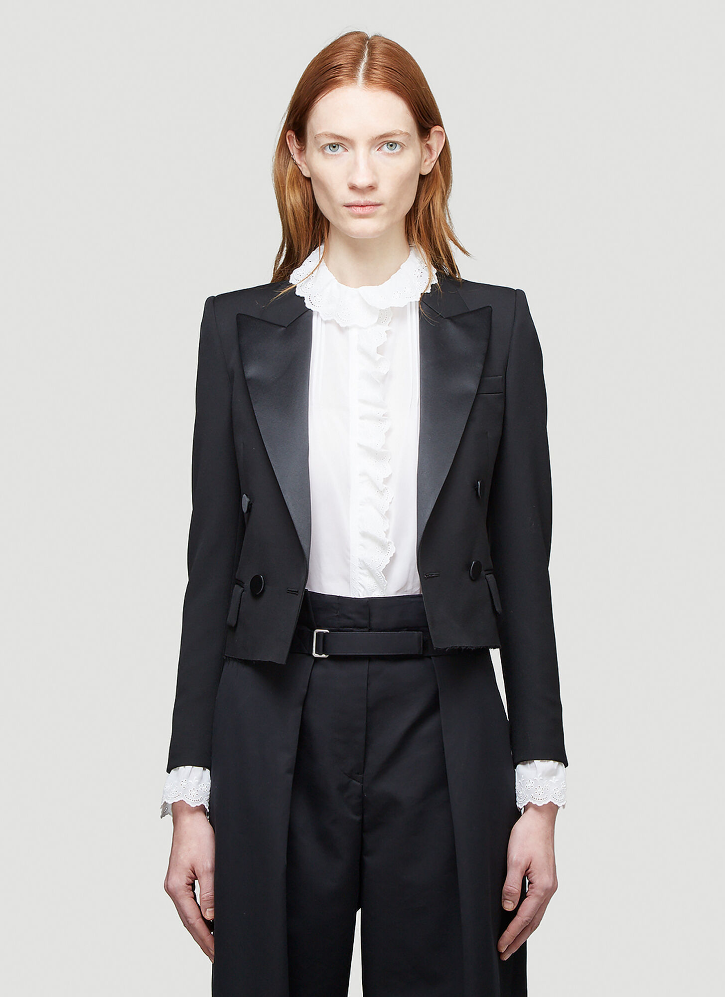 female Black 100% Wool. Dry clean.