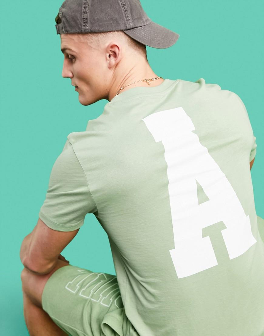 ASOS Actual t-shirt in green with large back varsity logo print